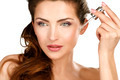 Closeup of a beautiful woman applying a beauty treatment - PhotoDune Item for Sale