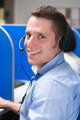 call center operator with headset smiling - PhotoDune Item for Sale