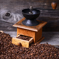 Manual coffee grinder with beans on wooden background - PhotoDune Item for Sale
