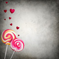 Two colorful lollipops with floating hearts on grunge background - PhotoDune Item for Sale
