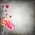 Two lollipops with floating hearts, bokeh on grunge background - PhotoDune Item for Sale