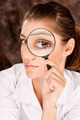 researcher looking through magnifier glass - PhotoDune Item for Sale
