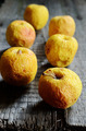 wrinkled yellow apples on a wooden - PhotoDune Item for Sale