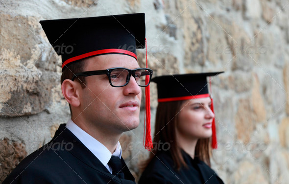 Young Couple in the Graduation Day  - Stock Photo - Images