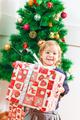 Little Girl Holding a Christmas Gift - PhotoDune Item for Sale