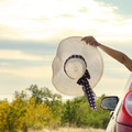 Woman shows sun hat from car - PhotoDune Item for Sale