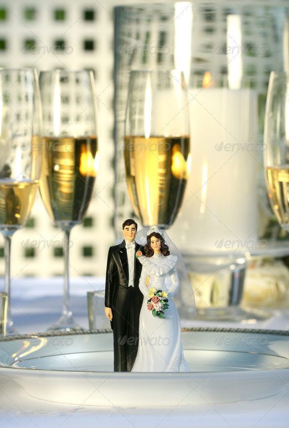 Wedding cake figurines on dinner plate - Stock Photo - Images