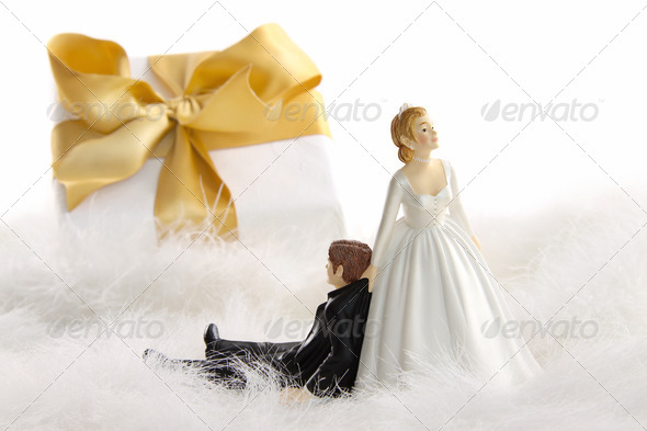 Wedding cake figurines with gift on white - Stock Photo - Images