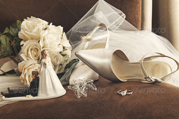 Bouquet of white roses and wedding shoes on chair - Stock Photo - Images