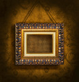 Gold picture frame on antique wallpaper - PhotoDune Item for Sale
