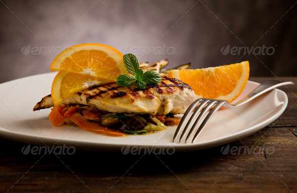 Grilled chicken breast on ratatouille bed - Stock Photo - Images