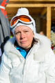 middle-aged woman in a white jacket  ski  glasses - PhotoDune Item for Sale