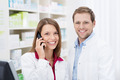 Smiling pharmacist chatting on the phone - PhotoDune Item for Sale