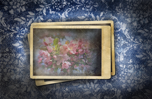 Grungy denim with faded floral effect - Stock Photo - Images