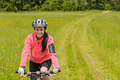 Woman riding bicycle on meadow path - PhotoDune Item for Sale