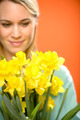 Woman with spring yellow flower narcissus - PhotoDune Item for Sale