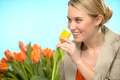 Woman smelling one yellow tulip spring flowers - PhotoDune Item for Sale