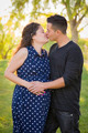 Hispanic Man Kisses His Pregnant Wife and Feels Their Baby Kick Outdoors At the Park. - PhotoDune Item for Sale