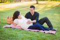 Peaceful Pregnant Hispanic Couple in The Park Outdoors. - PhotoDune Item for Sale