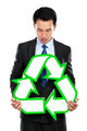 Portrait of businessman holding recycle sign - PhotoDune Item for Sale