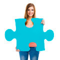 Woman holding a puzzle - PhotoDune Item for Sale