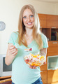 long-haired blonde girl eating  fruit salad - PhotoDune Item for Sale