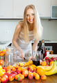 cheerful blonde housewife making alcoholic cocktail - PhotoDune Item for Sale