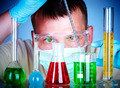 scientist in laboratory with test tubes - PhotoDune Item for Sale