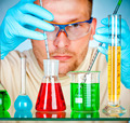 Young scientist in laboratory with test tubes - PhotoDune Item for Sale