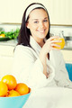 Smiling woman with orange juice in the kitchen - PhotoDune Item for Sale