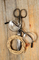 old scissors, glasses and hank of packthread on wooden backgroun - PhotoDune Item for Sale