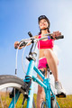 woman biker riding Folding Bicycle  with blue sky  - PhotoDune Item for Sale