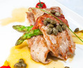meat with asparagus on a table in a restaurant - PhotoDune Item for Sale
