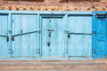 Blue doors locked with padlocks - PhotoDune Item for Sale