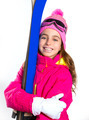 Kid girl ski with snow equipment goggles and winter hat - PhotoDune Item for Sale