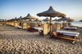 sunbeds and beach umbrella in Marsa Alam, Egypt - PhotoDune Item for Sale
