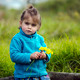 Little girl holds yellow flowers - PhotoDune Item for Sale
