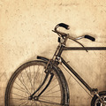 Old rusty bicycle on grunge wall background - PhotoDune Item for Sale