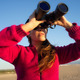 Ecologist Woman Watching the Environment with Binoculars - PhotoDune Item for Sale