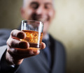 Vintage businessman holding a glass of whisky - PhotoDune Item for Sale