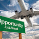 Opportunity Green Road Sign and Airplane Above with Dramatic Blue Sky and Clouds. - PhotoDune Item for Sale