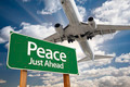 Peace Green Road Sign and Airplane Above with Dramatic Blue Sky and Clouds. - PhotoDune Item for Sale