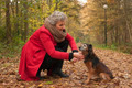 Retired woman is caring of her dog - PhotoDune Item for Sale
