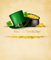 Saint Patrick's Day background with clover leaves, green hat and gold coins in a cauldron.  - PhotoDune Item for Sale