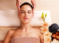 Masseur doing massage the head of an woman in spa salon - PhotoDune Item for Sale