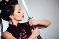 Woman with japan sword katana in hands - PhotoDune Item for Sale