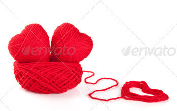 Two knitted hearts in a nest from threads - PhotoDune Item for Sale