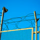 razor wire barbed wire top of security fence - PhotoDune Item for Sale