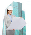 smiling architect in white helmet with blueprints - PhotoDune Item for Sale