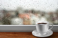 Coffee cup against window with rainy day view - PhotoDune Item for Sale